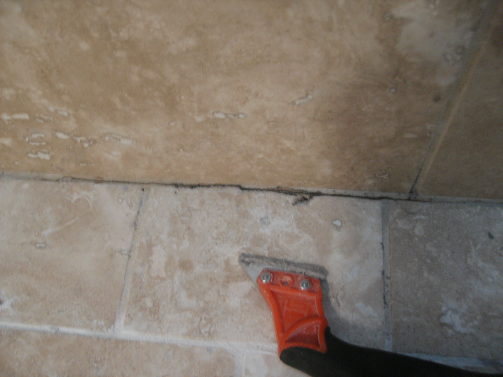 in grout you can carefully scrape out the surface to clean grout