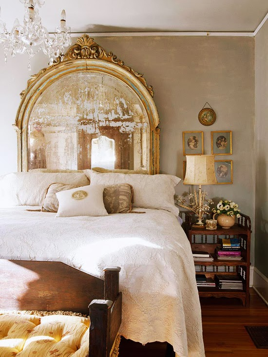 beautiful antique gold mirror behind a bed