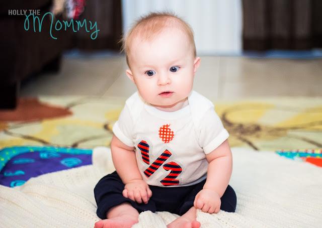 milestones 6 month baby sitting