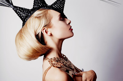 Test shots for model looking for agency work. Futuristic glam shoot. Sculptural hair accessorised by dramatic headdress
