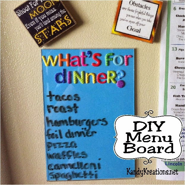 "Keep track of What's for Dinner with this easy and fun Menu Board DIY.  With just a few simple dollar store items, you will be organized and on budget without the dreaded ""What's for dinner"" every night."