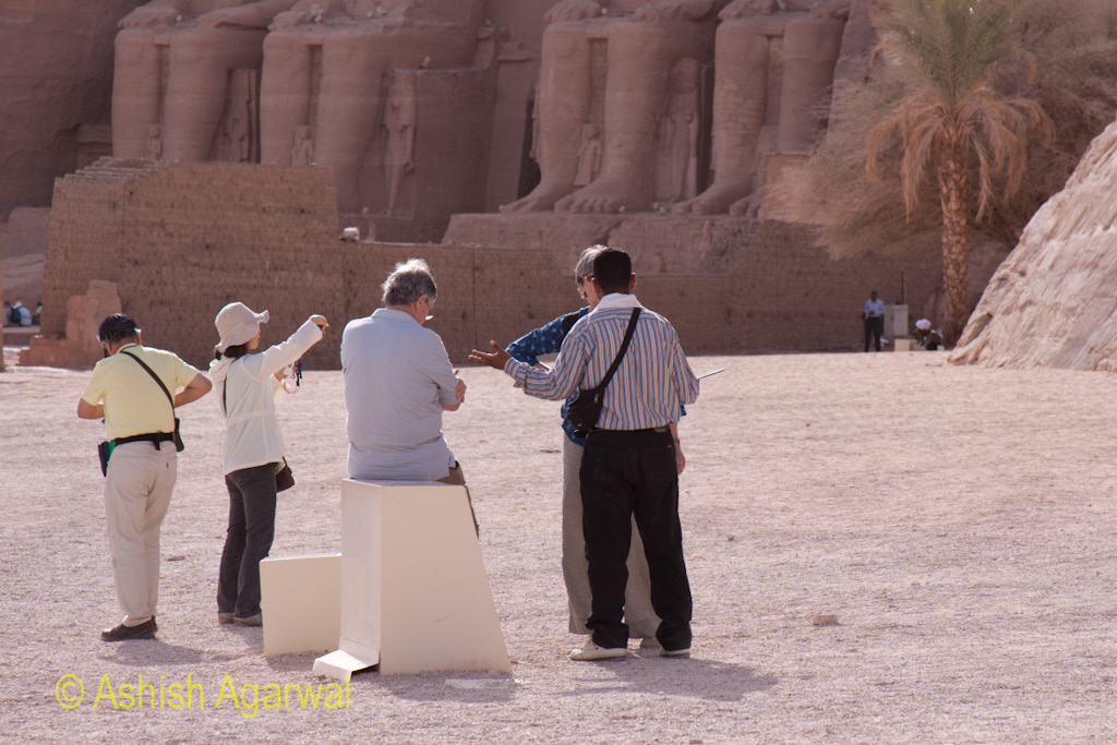 Tourists along with their guide at the temple of Abu Simbel in south Egypt