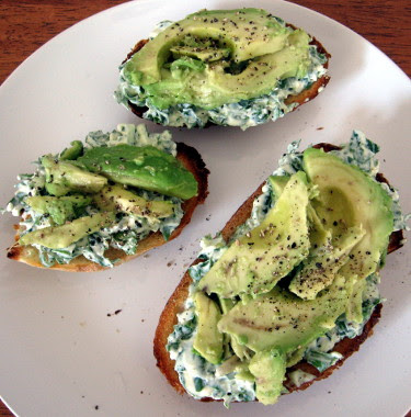 tosted sourdough with cream cheese, herbs, and avocado