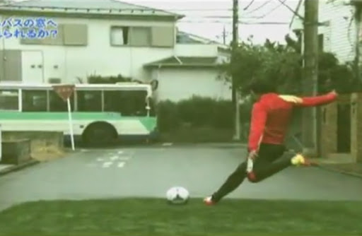 Set-piece specialist Shunsuke Nakamura aims a free-kick at a moving bus