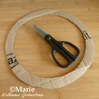 Scissors used to cut out wreath shape from card