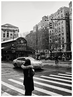 A woman hailing a cab in New York City