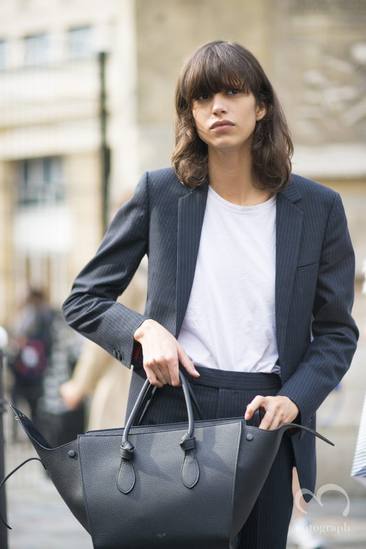 Model Mica Arganaraz carries Celine bag and wears a suit during Paris Fashion Week 2015 Spring Summer PFW