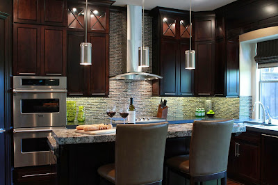 the kitchen is small with wooden cabinetry and granite counter top
