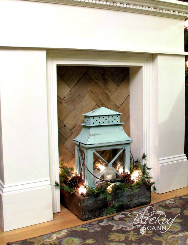 Blue roof cabin faux mantel updated with rustic wood Fireplace ideas no fire