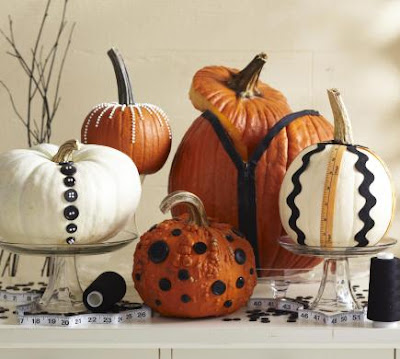 Fun Sewing theme Fall Centerpiece with pumpkins from midwestliving.com