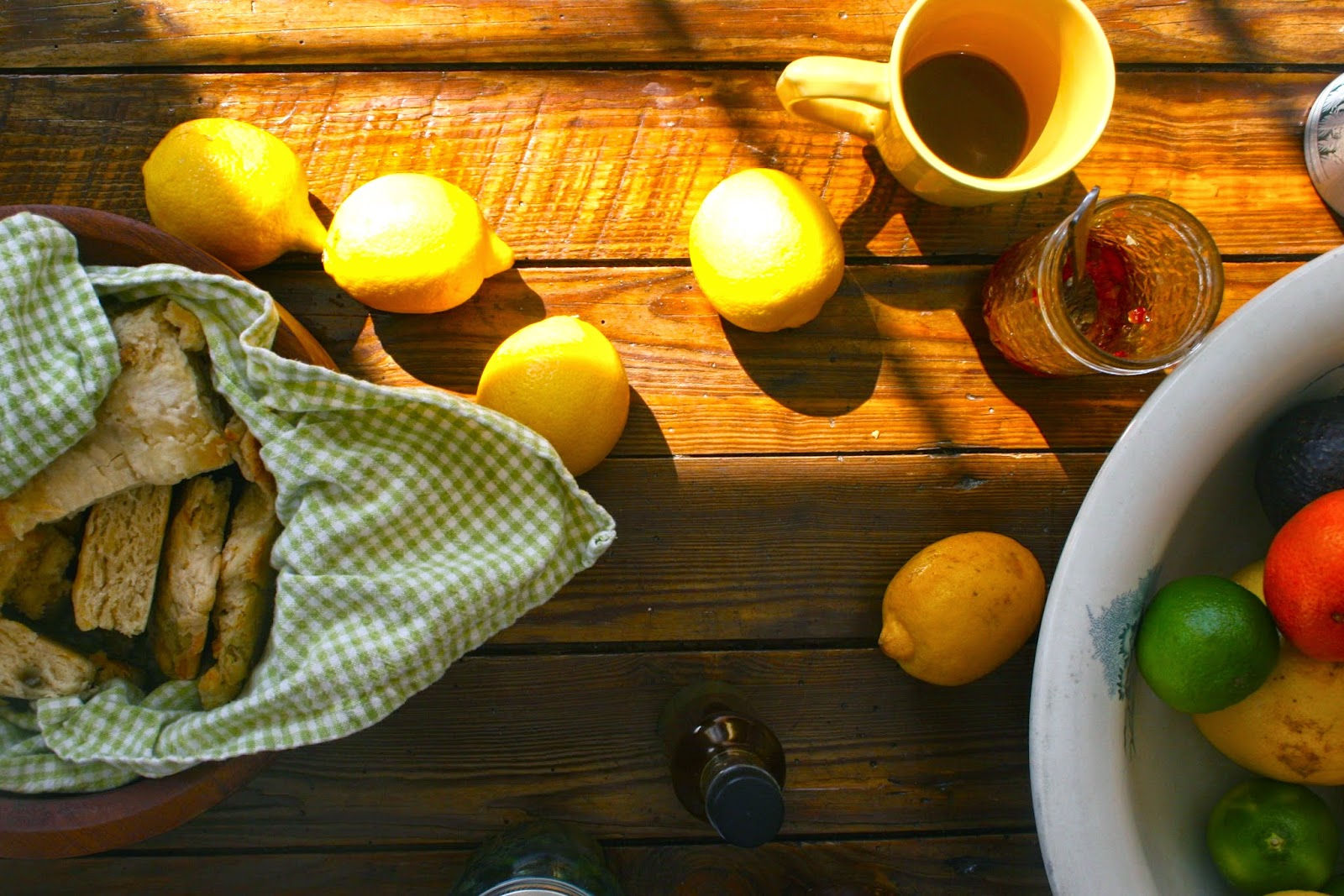 Lemons, Limes, Oranges and Grapefruit on Table with Biscuits and Jam