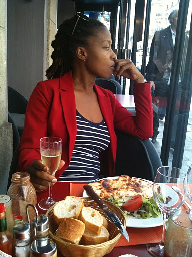 black woman in parisian cafe