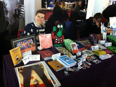 Photo of Dom McKenzie and his stall at Thought Bubble convention from November 2013