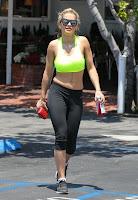 Rita Ora tight pants and bright green top