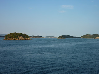 Small islands in Seto inland sea taken from a ferry travelling from Naoshima (Miyanoura) to Uno
