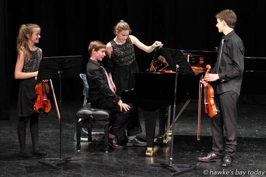 L-R: Allie Chesterman, Louis Daysh, Imogen Daysh, Gerard Chesterman, a quartet practising Goyishe, composed by Marcus Jackson, a finalist in the annual NZSM composer competition, pictured at Lindisfarne College, Hastings. photograph