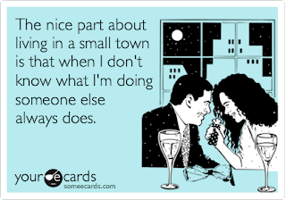 Image description: e-card with a couple dining and a text that reads: The nice part about living in a small town is that when I don't know what I'm doing someone else always does.