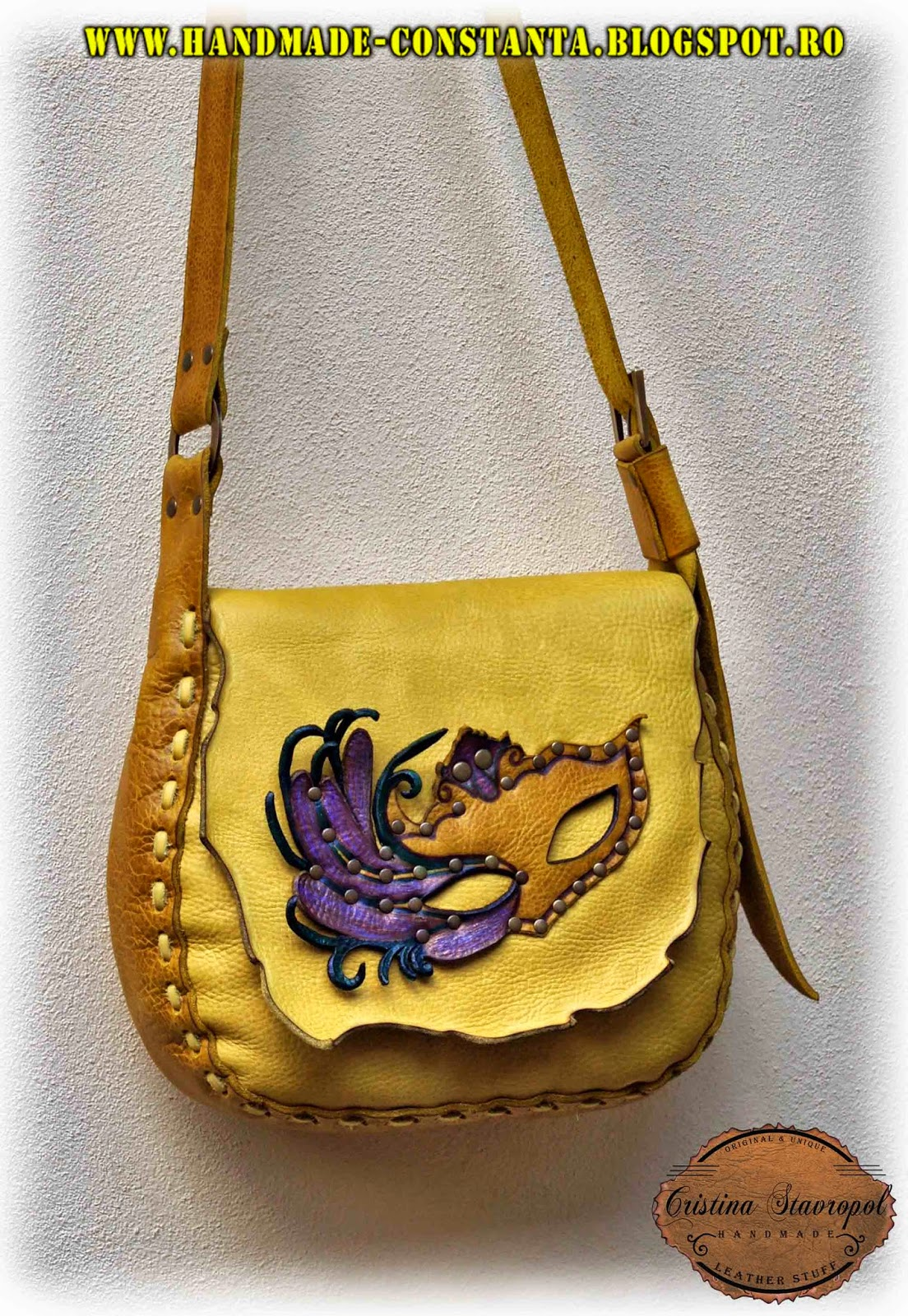 Leather bag with carnival mask.