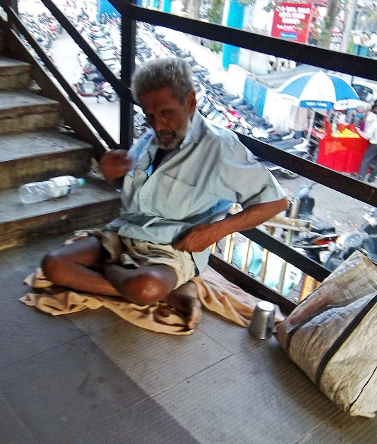 beggar begging at railway station
