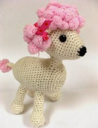 http://www.ravelry.com/patterns/library/pomp-a-puppy