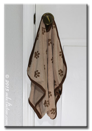 Luv and Emma's Dry Pets towel hangin on door knob