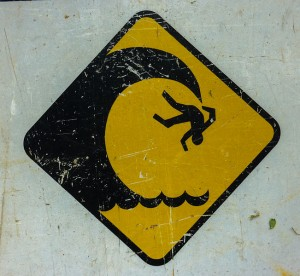 Falling off a cliff sign