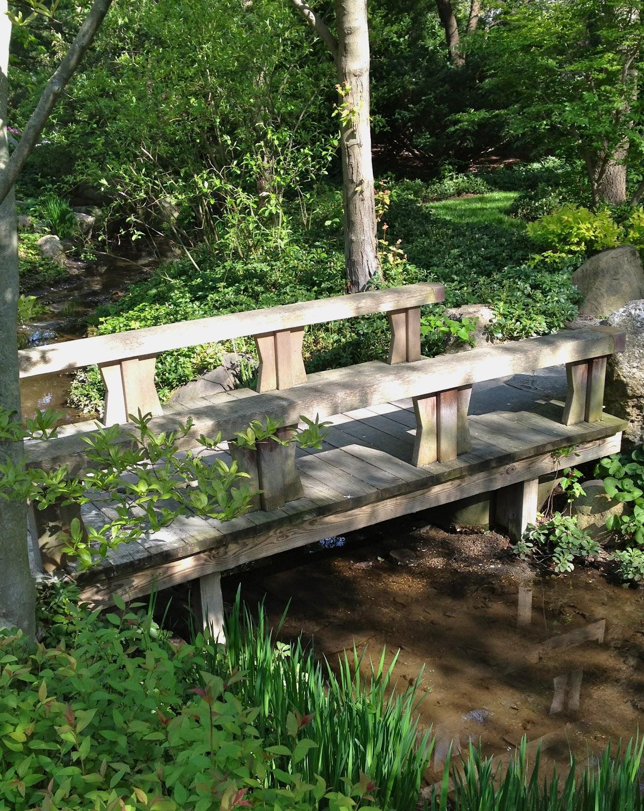 Garden of reflection bridges in japanese gardens for Japanese garden pond bridge