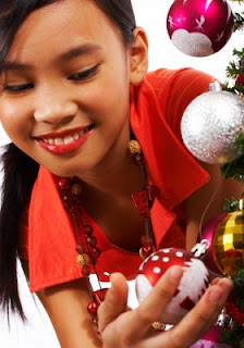 girl looking at christmas decorations NAMC montessori grace and courtesy practical life activities