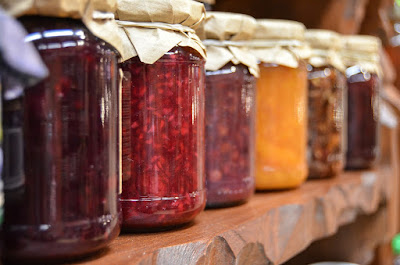 Jars of preserves lined up on a shelf