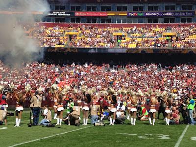 Robert Griffin III runs onto FedEx Field during Washington Redskins player introductions