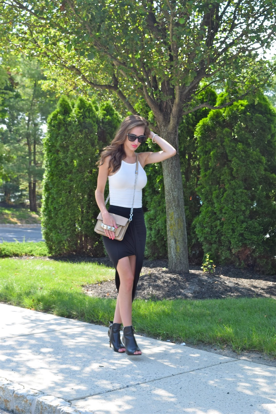 Wearing American Eagle Crop Top Tee, Express Black Wrapped Skirt, Linea Pelle Grayson Bar Bag, Valentino Rockstud Sunglasses