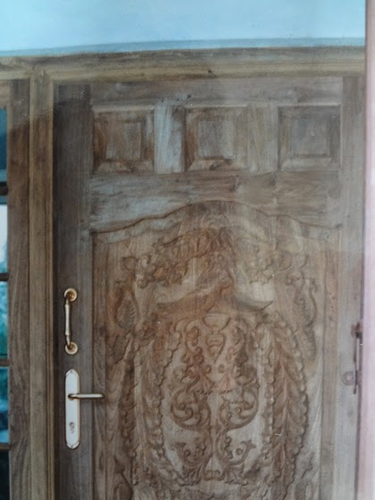Wooden Front Door designs Kerala Style