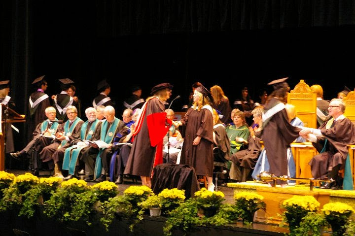 Crossing the stage at UAlberta