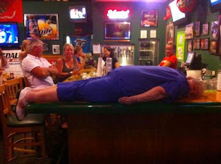 funny picture: drunk sleeping on the bar at the cafe