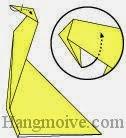 Bước 8: Gấp góc giấy vào trong giữa hai lớp giấy.