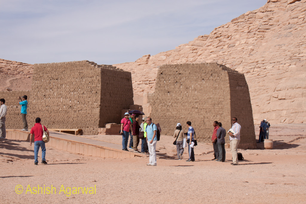 Tourists at the foot of a structure right next to the Abu Simbel temple near Aswan