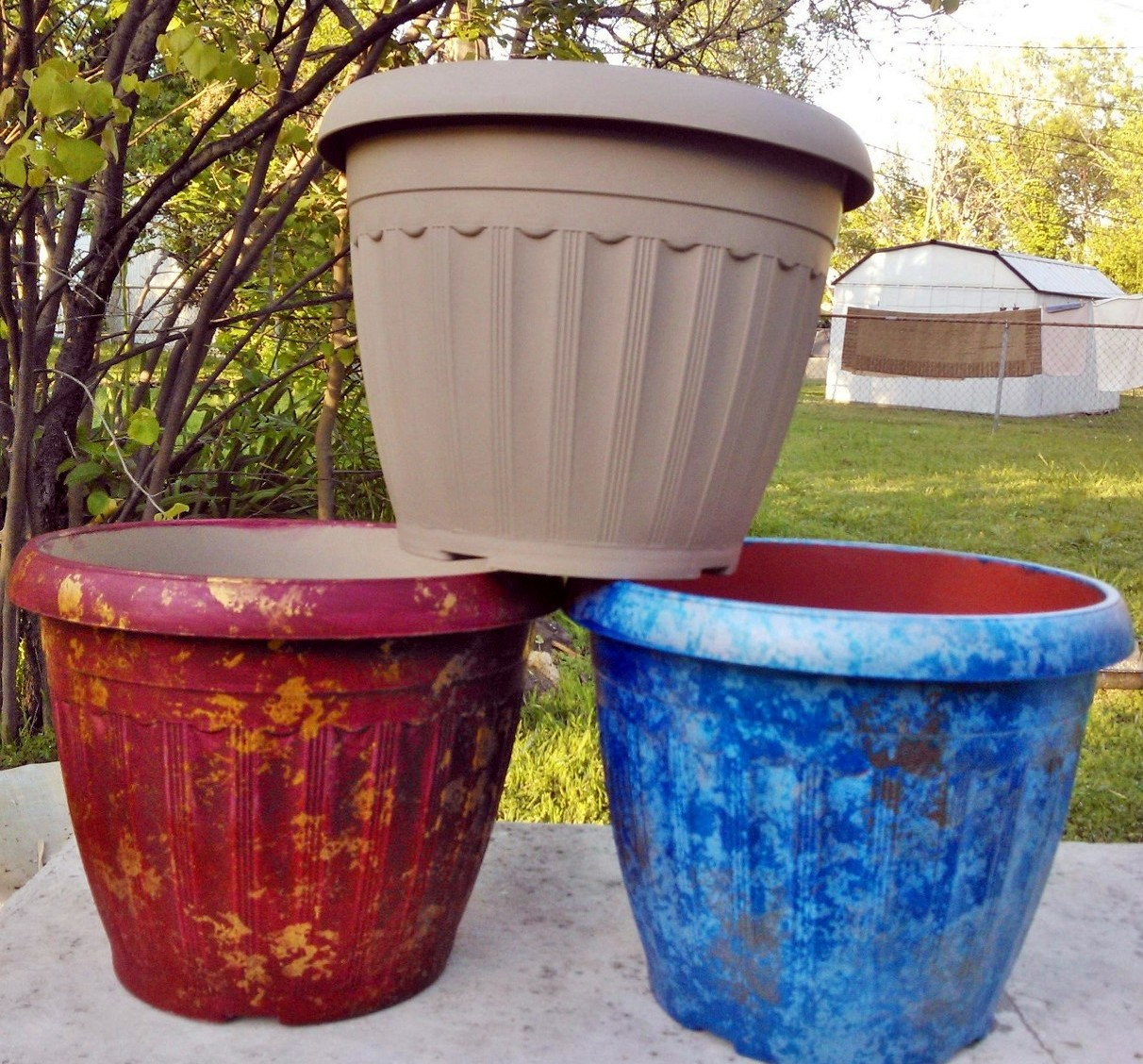 ll's life and times: international painted plastic flower pots