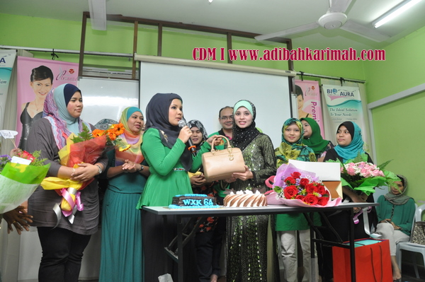 CDM Adibah Karimah in Green leaders group of premium beautiful