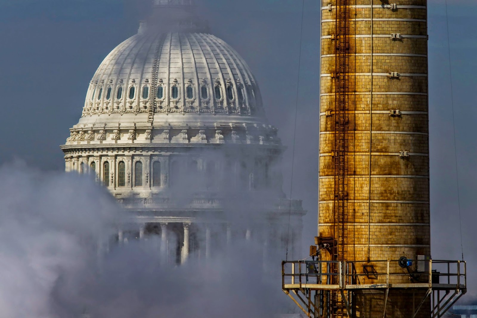 A view of the Capitol from the Capitol Power Plant, a coal-burning plant in Washington. Americans are less likely to vote for candidates who question or deny the science of human-caused global warming, a poll found. (Credit: Jim Lo Scalzo/European Pressphoto Agency) Click to Enlarge.