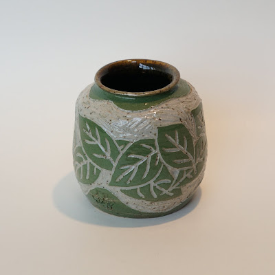 Unique wheelthrown sgraffito pottery ceramic vase with leaf design by Lily.