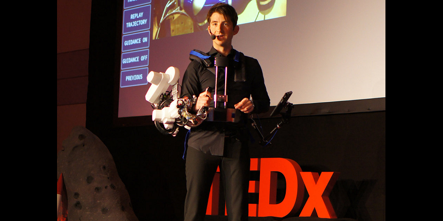 Dr André Schiele, Head of ESA's Telerobotics & Haptics Laboratory, performed a breathtaking demonstration of how robotics technology developed for the International Space Station may enable breakthroughs for robotics operations down here on Earth. Donning an exoskeleton that weighs just 10 kg, he controlled a robot at ESA's technical heart in Noordwijk, the Netherlands, over 400 km away. Credit: C.Riemenschneider