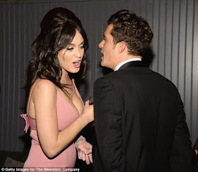 Single Katy Perry & Orlando Bloom flirt at Golden Globes afterparty