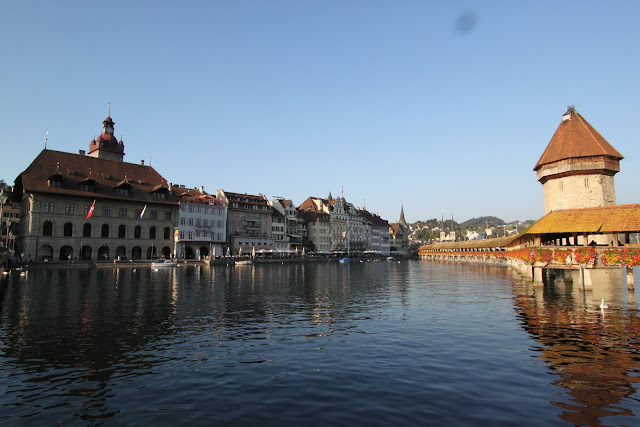 Chapel Bridge (Kapellbrucke) with Wasserturm (water tower) along Lake Lucerne in Lucerne, Switzerland