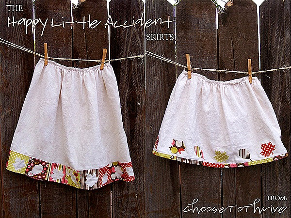 thanksgiving skirts, white with leaves, hanging in front of a wooden fence