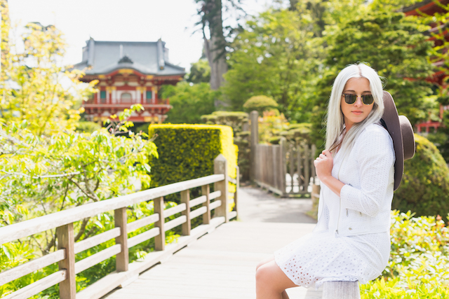 Bryn Newman of Stone Fox Style in a Rebecca Minkoff Eyelet jacket and dress at the Japanese Tea Gardens in San Francisco. Perfect summer outfit idea and the BEST Summer Travel Wanderlust playlist!
