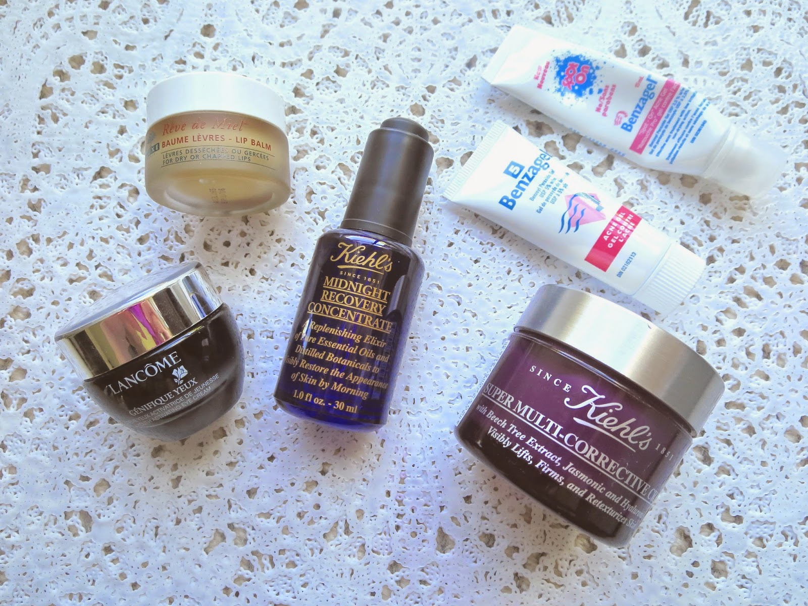 a picture of Moisturizers & Treatments ; Kiehl's Midnight Recovery Concentrate, Kiehl's Super Multi Corrective Cream, Nuxe Reve de miel, Lancome genefique eye cream, benzagel 5, benzagel spot on