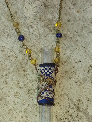 upcycled glass vial necklace with recycled fibers and beads