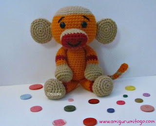 orange crochet sock monkey