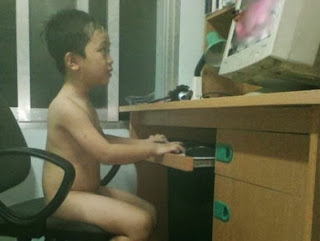 funny picture: Chinese child sits behind computer