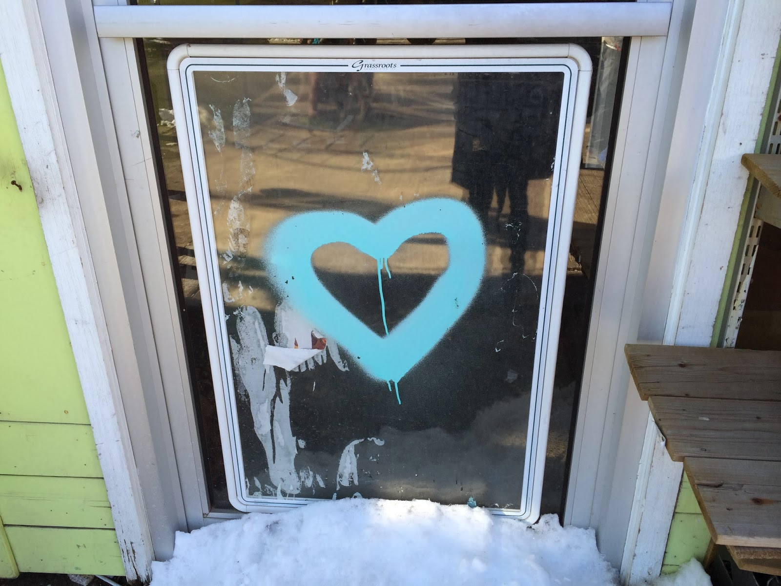 blue heart spray painted on a window